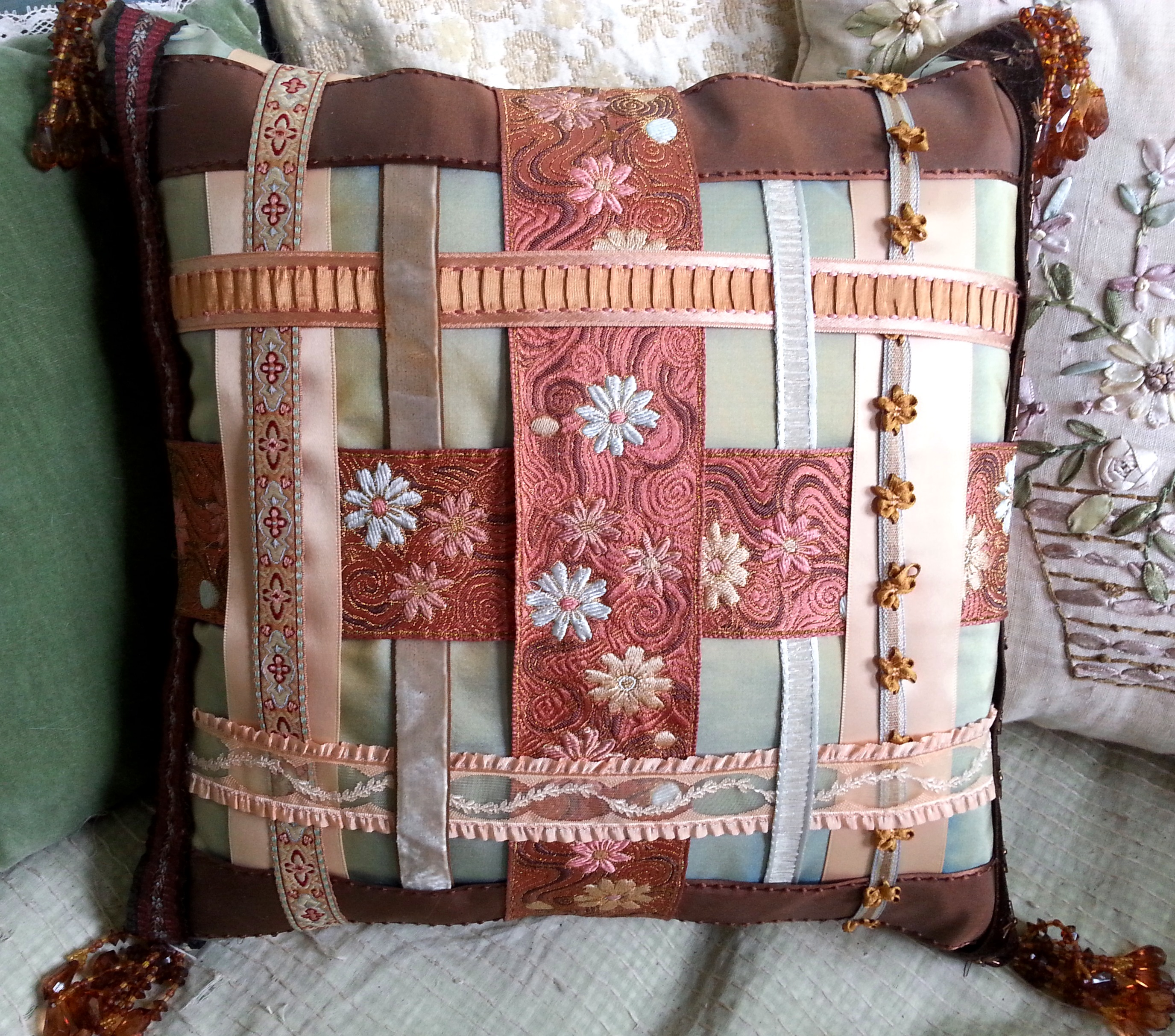 This is the very first pillow I ever made. These ribbons are all from Cush Cush fabrics where I had my artistic epiphany (see My Story Part I). I took a 3 hour sewing class at Stitch Lab to make this pillow. My first time ever sewing a pillow.