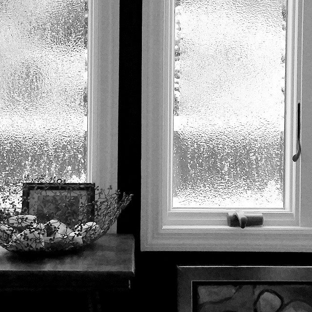 Solid ice on designer Susan Serra's windows creates a textural winter landscape.  Photo courtesy of Susan Serra of The Kitchen Designer.