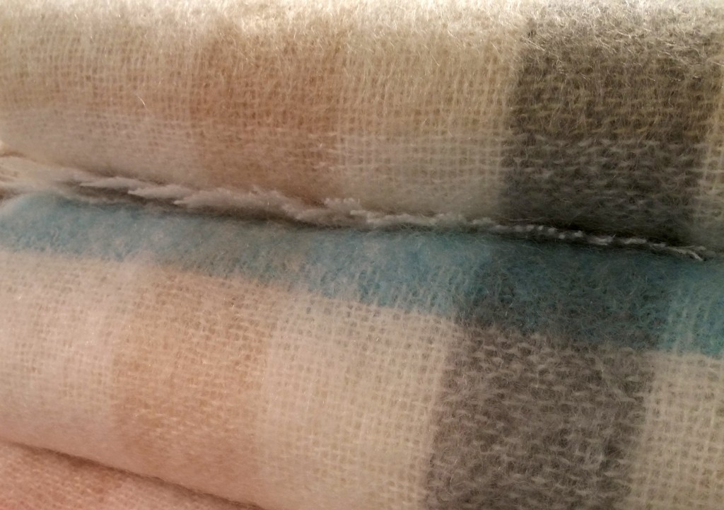 Fell in love with the soft, wintry white, gray and pastel colors of these throws by Peacock Alley.