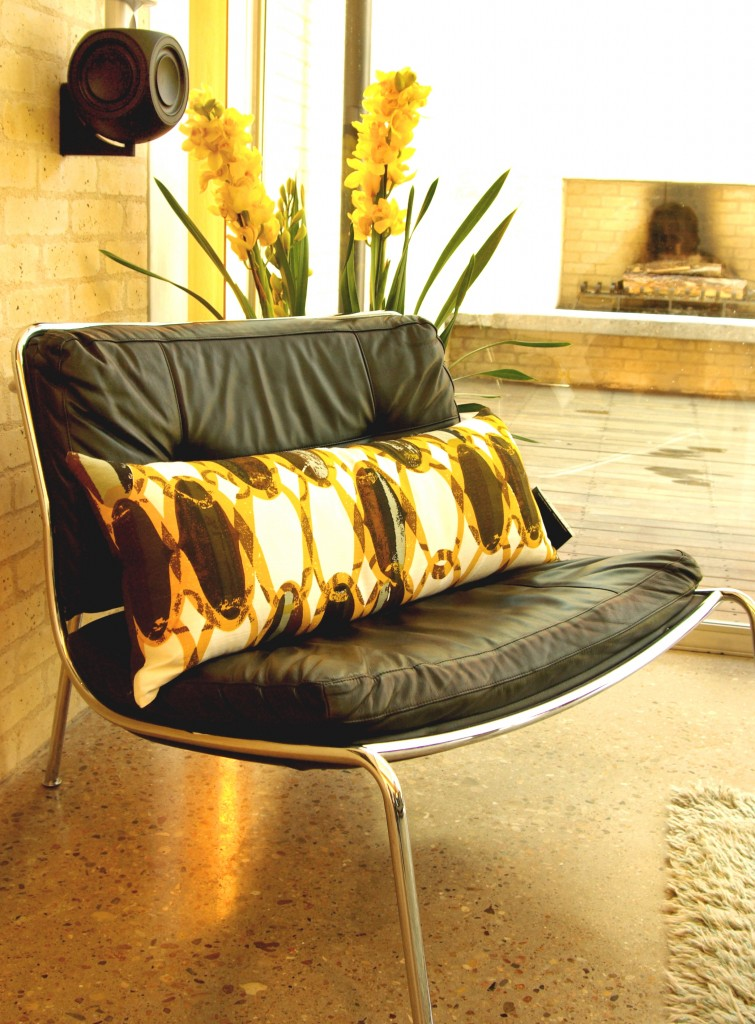 Mid-century chain link pillow backed with chocolate faux ostrich. Modern Home Tour Austin. Photography by Gregg Cestaro.